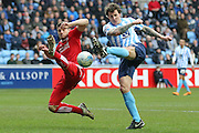 Swindon Town defender Jamie Sendles-White (21)   blocks the shot from Coventry City forward Darius Henderson (44)  during the Sky Bet League 1 match between Coventry City and Swindon Town at the Ricoh Arena, Coventry, England on 19 March 2016. Photo by Simon Davies.