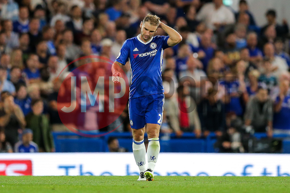 Branislav Ivanovic of Chelsea looks dejected after James Collins of West Ham United scores a goal to make it 1-1 - Rogan Thomson/JMP - 15/08/2016 - FOOTBALL - Stamford Bridge Stadium - London, England - Chelsea v West Ham United - Premier League Opening Weekend.