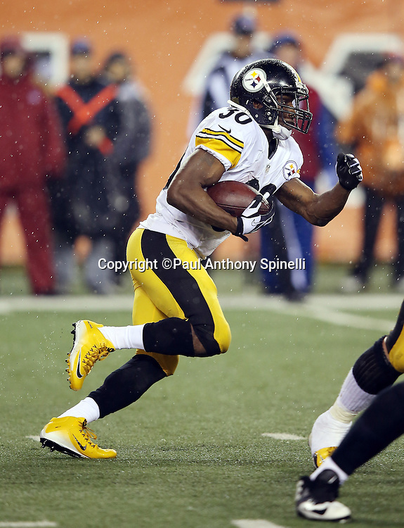 Pittsburgh Steelers running back Jordan Todman (30) runs the ball during the NFL AFC Wild Card playoff football game against the Cincinnati Bengals on Saturday, Jan. 9, 2016 in Cincinnati. The Steelers won the game 18-16. (©Paul Anthony Spinelli)