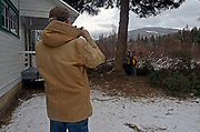 Local Yaak Valley resident Michael Tucker photographs neighbors Bob and Dori Goodwin at the presentation for the cutting down of the 2017 Capitol Christmas Tree from the Historic Upper Ford Ranger Station in the upper Yaak Valley. Kootenai National Forest in the Purcell Mountains, northwest Montana.
