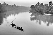 Men punting a boat in South India.