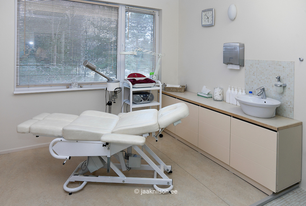 Massage treatment room, table and sink with equipment on trolley in Viimsi Spa Hotel, Tallinn