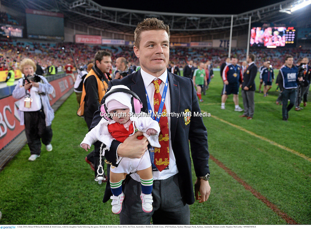 6 July 2013; Brian O'Driscoll, British & Irish Lions, with his daughter Sadie following the game. British & Irish Lions Tour 2013, 3rd Test, Australia v British & Irish Lions. ANZ Stadium, Sydney Olympic Park, Sydney, Australia. Picture credit: Stephen McCarthy / SPORTSFILE