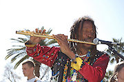 Jomo plays his golden flute during the Spirit Familia concert at Carnaval Spring Festival in Tucson, Arizona.