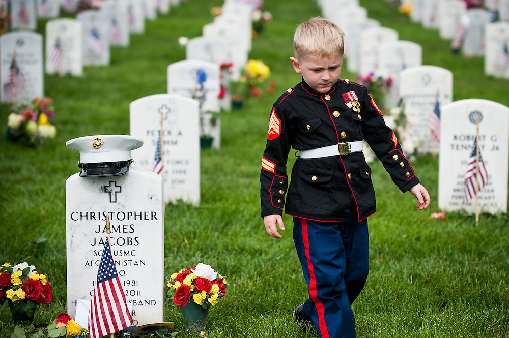 On Memorial Day, Christian Jacobs, 5, of Hertford, NC, walks past the headstone of his father, Marine Sgt. Christopher Jacobs, in Section 60 at Arlington National Cemetery in Arlington, Virginia, USA, on 30 May 2016.