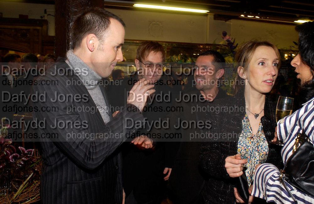 David Furnish, Sir Elton John, Shaun Leane and Sam Taylor Wood. Party hosted by Isabella Blow in honour of Shaun Leane to celebrate his jewelry collection. Liberty's. London. 8 December 2004. ONE TIME USE ONLY - DO NOT ARCHIVE  © Copyright Photograph by Dafydd Jones 66 Stockwell Park Rd. London SW9 0DA Tel 020 7733 0108 www.dafjones.com