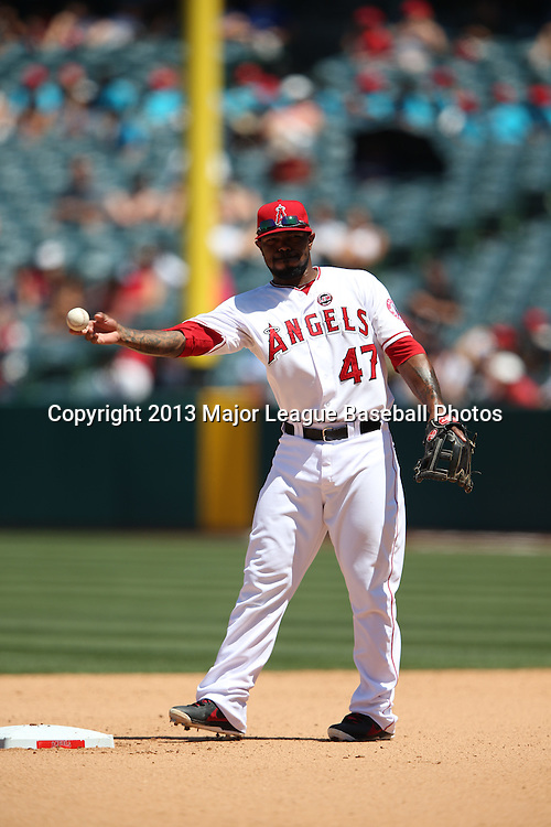 ANAHEIM, CA - JULY 24:  Howie Kendrick #47 of the Los Angeles Angels of Anaheim throws the ball during the game against the Minnesota Twins on Wednesday, July 24, 2013 at Angel Stadium in Anaheim, California. The Angels won the game in a 1-0 shutout. (Photo by Paul Spinelli/MLB Photos via Getty Images) *** Local Caption *** Howie Kendrick