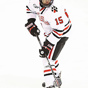 Kevin Roy #15 of the Northeastern Huskies warms up on the ice prior to the game against the Minnesota Gophers at Matthews Arena on November 29, 2014 in Boston, Massachusetts. (Photo by Elan Kawesch)