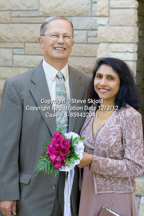 East Indian American bride and white husband age 59 and 67 after marriage in Catholic Church. Minneapolis Minnesota MN USA