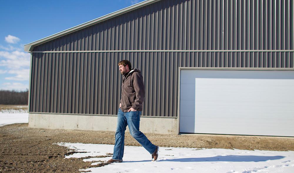 Jonathan Giret walks by his barn at his farm near West Lorne, Ontario, Thursday, February 2, 2017.<br /> Farmers Forum/ Geoff Robins