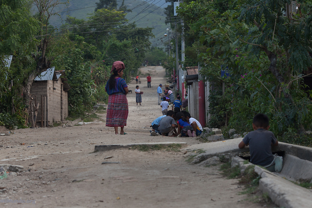Panorama of the community of Pacux, where the former Achi Mayan residents of Rio Negro were resettled after the destruction of their village, numerous massacres, and flooding of the Chixoy river basin. Pacux, originally planned as a so-called model village where they army would resettle civilians from areas controlled by the guerrillas, lies in the outskirts of Rabinal city. It is plagued today by poverty and crime as the citizens of Pacux are still outcast as former guerrillas by large sectors in Rabinal. Pacux, Rabinal, Baja Verapaz, Guatemala. July 16, 2014.