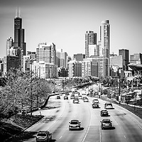 Downtown Chicago Lake Shore Drive black and white picture with downtown Chicago skyline and cars driving into the city.