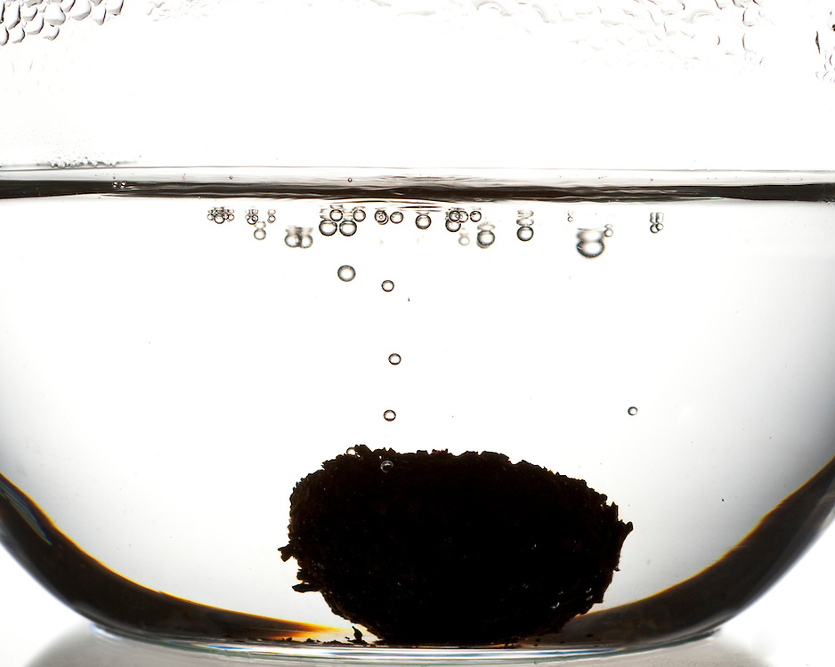 Pu erh brewing, and bubbling, in a tea pot.