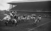 A A Mulligan, Irish scrum half, receives a pass from team mate and Captain A R Dawson, number 2, following a line out during the game at Landsdowne Road, Dublin on Saturday 14th February, 1959,.Included from left are, J A S Hackett and G Bendon, England, and Irish players B Wood, N H Brophy and R Kavanagh, ..Irish Rugby Football Union, Ireland v England, Five Nations, Landsdowne Road, Dublin, Ireland, Saturday 14th February, 1959,.14.2.1959, 2.14.1959,..Referee- D Gwynne Walters, Welsh Rugby Union, ..Score- Ireland 0 - 3 England, ..Irish Team, ..N J Henderson, Wearing number 15 Irish jersey, Full back, N.I.F.C, Rugby Football Club, Belfast, Northern Ireland,..N H Brophy, Wearing number 14 Irish jersey, Right wing, University College Dublin Rugby Football Club, Dublin, Ireland, ..A J O'Reilly, Wearing number 13 Irish jersey, Right Centre, Old Belvedere Rugby Football Club, Dublin, Ireland, and, Leicester Rugby Football Club, Leicester, England, ..J F Dooley, Wearing  Number 12 Irish jersey, Left Centre, Galwegians Rugby Football Club, Galway, Ireland, ..A C Pedlow, Wearing number 11 Irish jersey, Left wing,  C I Y M S Rugby Football Club, Belfast, Northern Ireland, ..M A English, Wearing number 10 Irish jersey, Outside Half, Bohemians Rugby Football Club, Limerick, Ireland,..A A Mulligan, Wearing number 9 Irish jersey, Scrum Half, London Irish Rugby Football Club, Surrey, England, ..B G Wood, Wearing number 1 Irish jersey, Forward, Garryowen Rugby Football Club, Limerick, Ireland, ..A R Dawson, Wearing number 2 Irish jersey, Captain of the Irish team, Forward, Wanderers Rugby Football Club, Dublin, Ireland, ..S Millar, Wearing number 3 Irish jersey, Forward, Ballymena Rugby Football Club, Antrim, Northern Ireland,..W A Mulcahy, Wearing number 4 Irish jersey, Forward, University College Dublin Rugby Football Club, Dublin, Ireland, ..M G Culliton, Wearing number 5 Irish jersey, Forward, Wanderers Rugby Football Club, Dublin, Ireland, ..N A Murphy, Wearing number 6 Iris