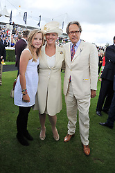 The EARL & COUNTESS OF MARCH and their daughter LADY ELOISE GORDON-LENNOX at the 3rd day of the 2012 Glorious Goodwood racing festival at Goodwood Racecourse, West Sussex on 2nd August 2012.