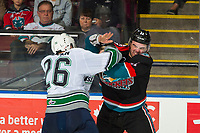 KELOWNA, CANADA - OCTOBER 10:  Nolan Volcan #26 of the Seattle Thunderbirds drops the gloves with Erik Gardiner #11 of the Kelowna Rockets on October 10, 2018 at Prospera Place in Kelowna, British Columbia, Canada.  (Photo by Marissa Baecker/Shoot the Breeze)  *** Local Caption ***