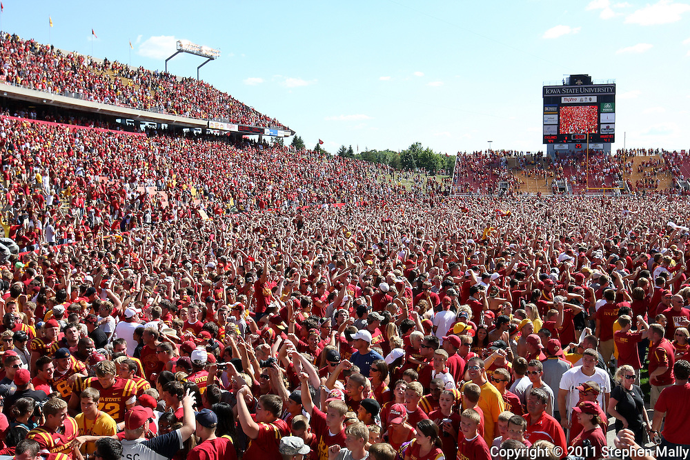 September 10, 2011: Iowa State fans celebrate on the field after the third overtime of the game between the Iowa Hawkeyes and the Iowa State Cyclones during the Iowa Corn Growers Cy-Hawk game at Jack Trice Stadium in Ames, Iowa on Saturday, September 10, 2011. Iowa State defeated Iowa 44-41 in 3OT.