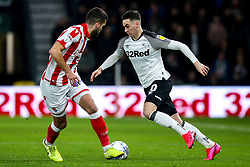 Tom Lawrence of Derby County takes on Tommy Smith of Stoke City - Mandatory by-line: Robbie Stephenson/JMP - 31/01/2020 - FOOTBALL - Pride Park Stadium - Derby, England - Derby County v Stoke City - Sky Bet Championship