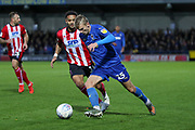 AFC Wimbledon attacker Marcus Forss (15) dribbling during the EFL Sky Bet League 1 match between AFC Wimbledon and Lincoln City at the Cherry Red Records Stadium, Kingston, England on 2 November 2019.