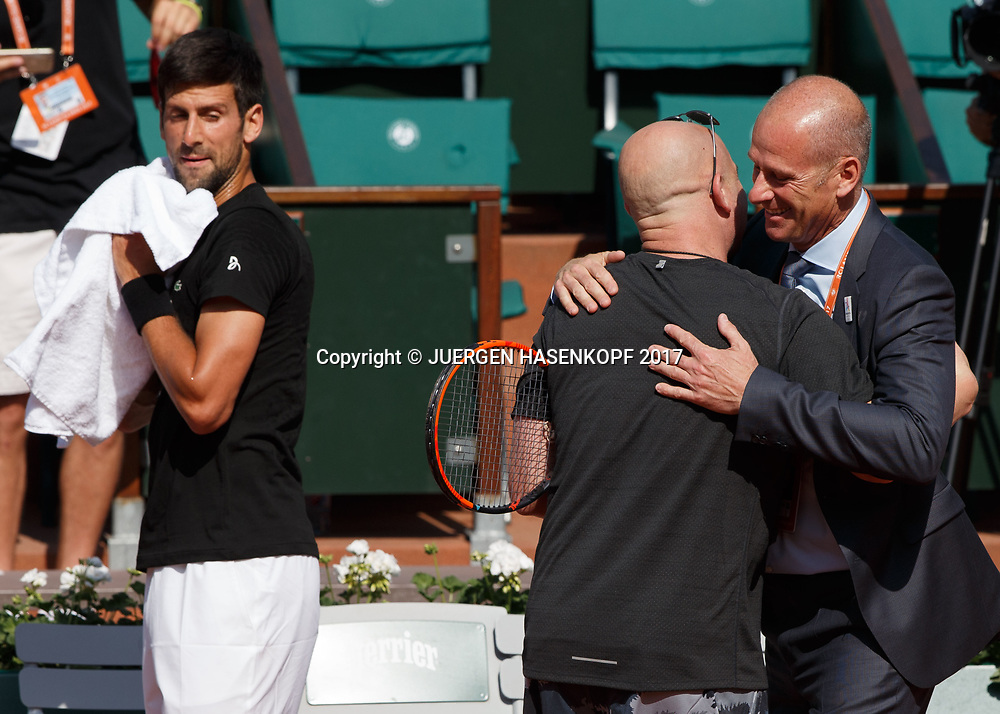 NOVAK DJOKOVIC (SRB), Training mit Coach Andre Agassi,Andre Agassi begruesst Turnierdirektor Guy Forget<br /> <br /> Tennis - French Open 2017 - Grand Slam ATP / WTA -  Roland Garros - Paris -  - France  - 29 May 2017.