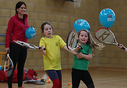 Primary three pupils Holly Anderson (right) with Emily Sorbie with teacher Rachel Aylott at Dunblane Primary school as they take part in the schools Miss-hits Tennis club in Andy Murray's home town, he has said he is aiming to end his career after Wimbledon but the Australian Open may be his last tournament.