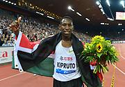 Conseslus Kipruto (KEN) poses with Kenyan flag after winning the steeplechase in 8:10.15 during the Weltklasse Zurich in an IAAF Diamond League meeting at Letzigrund Stadium in Zurich, Switzerland on Thursday, August 30, 2018.(Jiro Mochizuki/Image of Sport)