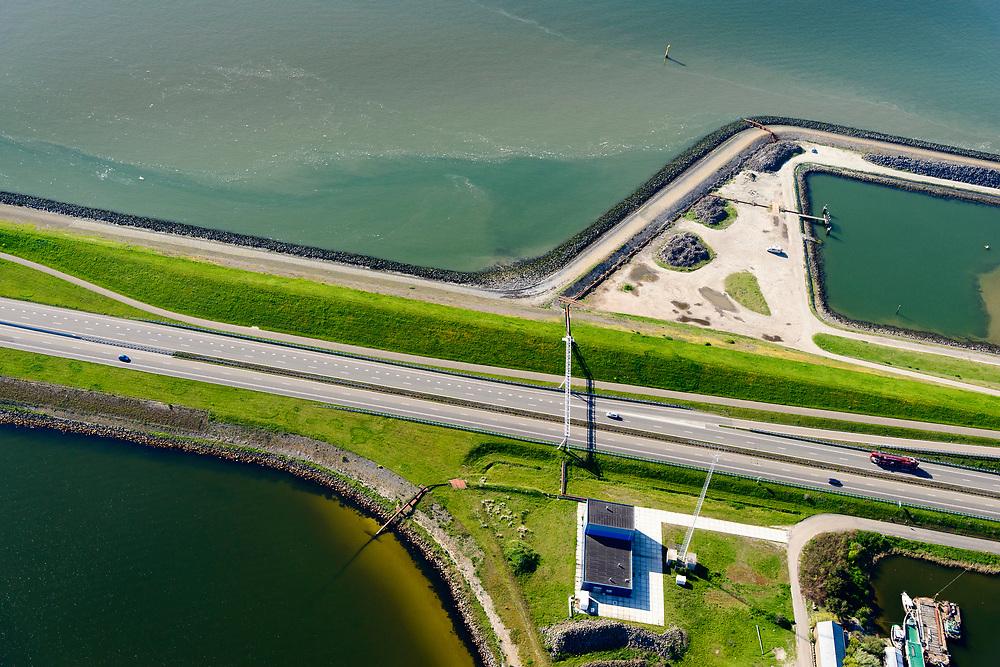 Nederland, Friesland, Gemeente Wonseradeel, 07-05-2018; Afsluitdijk ter hoogte van Breezanddijk, het voormalig werkeiland Breezand. .<br /> Het gebouw is de Blue Energy Centrale, proefopstelling voor opwekking vn elektriciteit waarbij gebruik gemaakt wordt van het verschil in zoutgehalte tussen de Noordzee (zout, boven) en het IJsselmeer (zoet, onder).<br /> Enclosure Dam at the height of Breezanddijk, former 'work island' Breezand.  IJsselmeer lake (bottom), the Wadden Sea (top)<br /> luchtfoto (toeslag op standard tarieven);<br /> aerial photo (additional fee required);<br /> copyright foto/photo Siebe Swart
