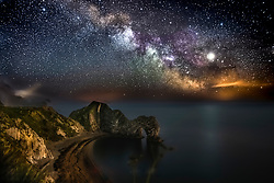**Live news rates apply**<br /> © Licensed to London News Pictures. Lulworth, UK. A long exposure highlights The Milky Way over Durdle Daw at Lulworth in Dorset, taken on May 5th, 2019. Photo credit: Peter Scott/LNP