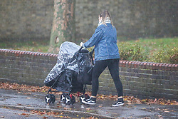 November 10, 2018 - London, United States - A woman seen pushing a pram during a heavy rainfalls in London. (Credit Image: © Dinendra Haria/SOPA Images via ZUMA Wire)
