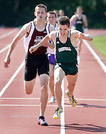 Cornwall's Mike Vecchio edges Kingston's Leroy Meirer at the finish line of the 1,600-meter run during the Section 9 track and field state qualifier in Middletown on Friday, May 31, 2013.