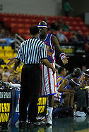 "05 May 2006: Kevin ""Special K"" Daley explains to the referee that he was just testing the arena buzzer during the Harlem Globetrotters vs the New York Nationals at the Sulivan Arena in Anchorage Alaska during their 80th Anniversary World Tour."