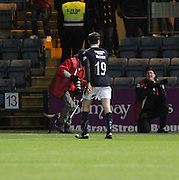 Dundee's Paul McGinn trudges off after conceding a penalty and being red carded for the challenge - Dundee v St Mirren, SPFL Premiership at <br /> Dens Park<br /> <br />  - &copy; David Young - www.davidyoungphoto.co.uk - email: davidyoungphoto@gmail.com