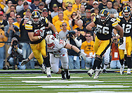 October 23 2010: Iowa Hawkeyes fullback Brett Morse (36) tries to run away from a tackle by Wisconsin Badgers defensive tackle J.J. Watt (99) during the first half of the NCAA football game between the Wisconsin Badgers and the Iowa Hawkeyes at Kinnick Stadium in Iowa City, Iowa on Saturday October 23, 2010. Wisconsin defeated Iowa 31-30.