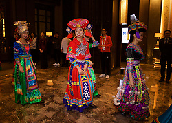 NANNING, CHINA - Monday, March 19, 2018: Woman in traditional costume greet the Wales team as they arrive at the Wanda Realm Resort in Nanning for the 2018 Gree China Cup International Football Championship. (Pic by David Rawcliffe/Propaganda)