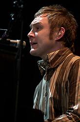 David Grey plays a Concert to a sellout Sheffield Hallam FM Arena  November 29 2002 Friday<br /><br />Copyright Paul David Drabble<br />Freelance Photographer<br />07831 853913<br />0114 2468406<br />www.pauldaviddrabble.co.uk<br /> [#Beginning of Shooting Data Section]<br />Nikon D1 <br /> 2002/11/29 21:48:55.1<br /> JPEG (8-bit) Fine<br /> Image Size:  2000 x 1312<br /> Color<br /> Lens: 80-200mm f/2.8-2.8<br /> Focal Length: 155mm<br /> Exposure Mode: Manual<br /> Metering Mode: Spot<br /> 1/250 sec - f/2.8<br /> Exposure Comp.: 0 EV<br /> Sensitivity: ISO 400<br /> White Balance: Auto<br /> AF Mode: AF-S<br /> Tone Comp: Normal<br /> Flash Sync Mode: Not Attached<br /> Color Mode: <br /> Hue Adjustment: <br /> Sharpening: Normal<br /> Noise Reduction: <br /> Image Comment: <br /> [#End of Shooting Data Section] David Grey plays a Concert to a sell out Sheffield Hallam FM Arena November 29 2002 Friday<br /> <br /> Copyright Paul David Drabble<br /> Freelance Photographer<br /> 07831 853913<br /> 0114 2468406