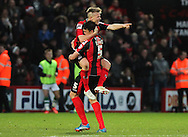 Picture by Tom Smith/Focus Images Ltd 07545141164<br /> 26/12/2013<br /> Matt Ritchie (left) of Bournemouth jumps onto Tommy Elphick (right) in celebration of scoring the goal to make it 2-0 to his side during the Sky Bet Championship match at the Goldsands Stadium, Bournemouth.
