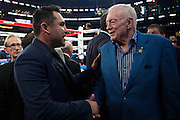 Oscar De La Hoya visits with Dallas Cowboys owner Jerry Jones after Canelo Alvarez defeated Liam Smith in front of over 51,000 fans at AT&T Stadium in Arlington, Texas on September 17, 2016.  (Cooper Neill for ESPN)