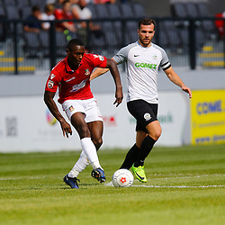 AUGUST 12:  Dover Athletic against Wrexham in Conference Premier at Crabble Stadium in Dover, England. Wrexham's defender Manny Smith makes a pass watched on by Dover's midfielder Mitch Brundle. (Photo by Matt Bristow/mattbristow.net)
