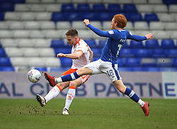 Oliver Turton of Blackpool (L) and Ben Pringle of Oldham Athletic in action - Mandatory by-line: Jack Phillips/JMP - 02/04/2018 - FOOTBALL - Sportsdirect.com Park - Oldham, England - Oldham Athletic v Blackpool - Football League One