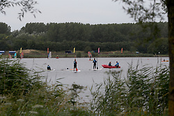 FRANCE GRANDE SYNTHE 2AUG17 - French youths enjoy watersports near a woodland designated as the unofficial Jungle II camp near Grande Synthe, Dunkirk, northern France. An estimated 300-400 stranded refugees are thought to be staying in the woodlands behind the lake.<br /> <br /> jre/Photo by Jiri Rezac<br /> <br /> © Jiri Rezac 2017