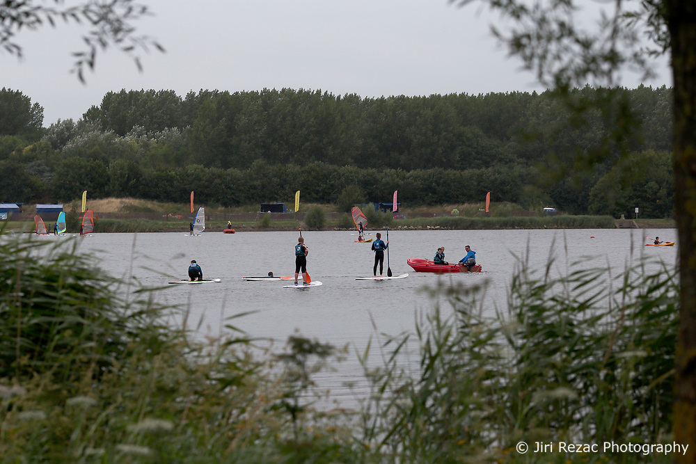 FRANCE GRANDE SYNTHE 2AUG17 - French youths enjoy watersports near a woodland designated as the unofficial Jungle II camp near Grande Synthe, Dunkirk, northern France. An estimated 300-400 stranded refugees are thought to be staying in the woodlands behind the lake.<br /> <br /> jre/Photo by Jiri Rezac<br /> <br /> &copy; Jiri Rezac 2017