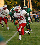 Sophomore Miles Hibbler (25) with the ball as the Troy Trojans play the Chaminade-Julienne Eagles at the West Carrollton Middle School stadium, Friday, August 26, 2011.