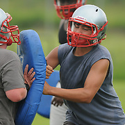 Matthew Ezzell, left, and Hayden Kreitzer of the Pender High School football team practice at the school Friday August 1, 2014. (Jason A. Frizzelle)
