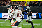 Chase Daniel (QB) of the Chicago Bears passes under pressure during the International Series match between Oakland Raiders and Chicago Bears at Tottenham Hotspur Stadium, London, United Kingdom on 6 October 2019.