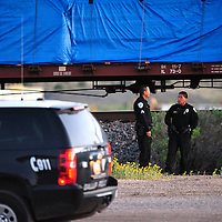 090314  Adron Gardner<br /> <br /> Gallup Police stand watch at the scene of a train versus pedestrian accident near KFC east in Gallup Wednesday.