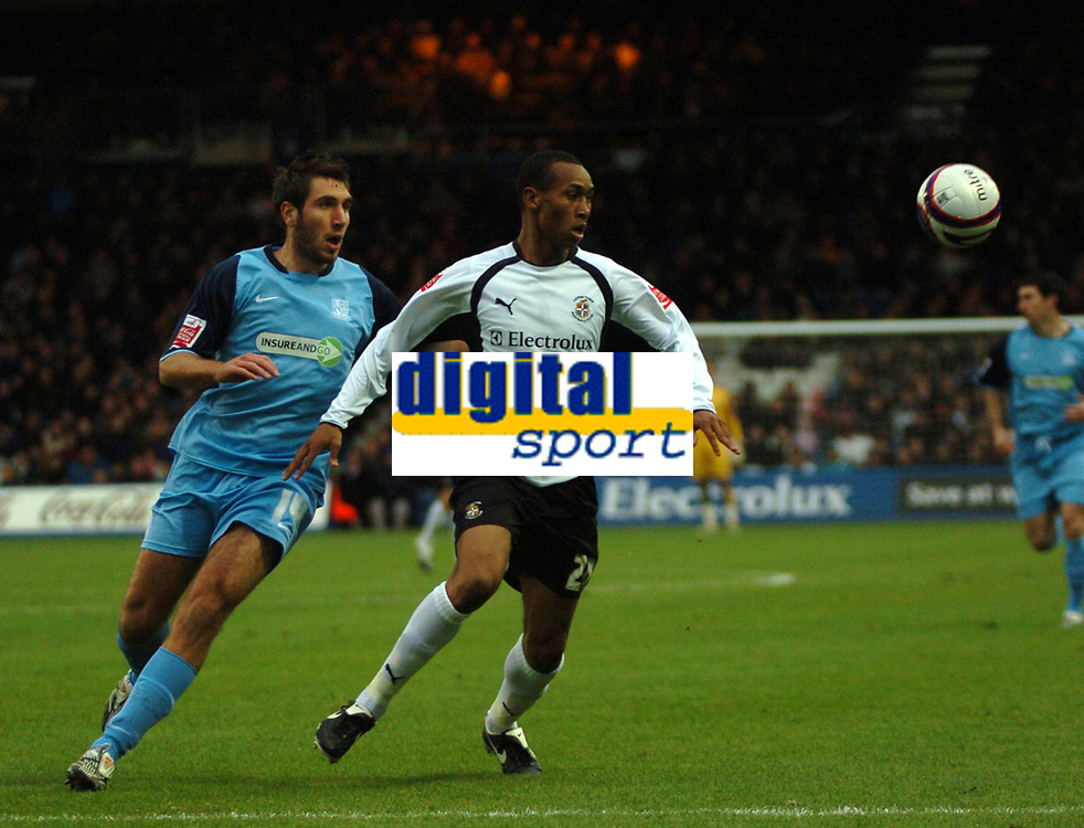 Photo: Tony Oudot/Sportsbeat Images.<br /> Luton Town v Southend United. Coca Cola League 1. 24/11/2007.<br /> Calvin Andrew of Luton Town beats Garry Richards of Southend to the ball