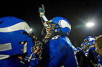 Coeur d'Alene High lineman Max Noll celebrates with his team Friday after the Vikings defeated Lake City High 45-13.