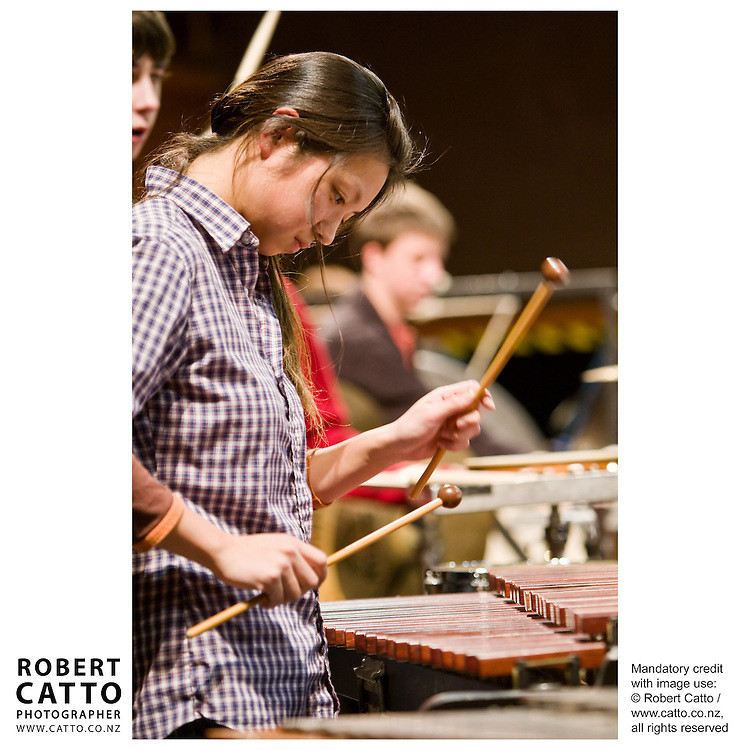 The New Zealand National Youth Orchestra rehearse for a concert with soloist Madeleine Pierard and conductor Jacques Lacombe, at the Michael Fowler Centre in Wellington...Programme: .RAVEL Alborada del Gracioso.ROUSSEL Bacchus et Ariane Suite No 2.CANTELOUBE Chants D?Auvergne.TABEA SQUIRE Feverdream (World Premiere).STRAVINSKY The Firebird Suite (1945)