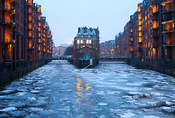Frozen canals during winter in Speicherstadt historic warehouse district in Hamburg Germany
