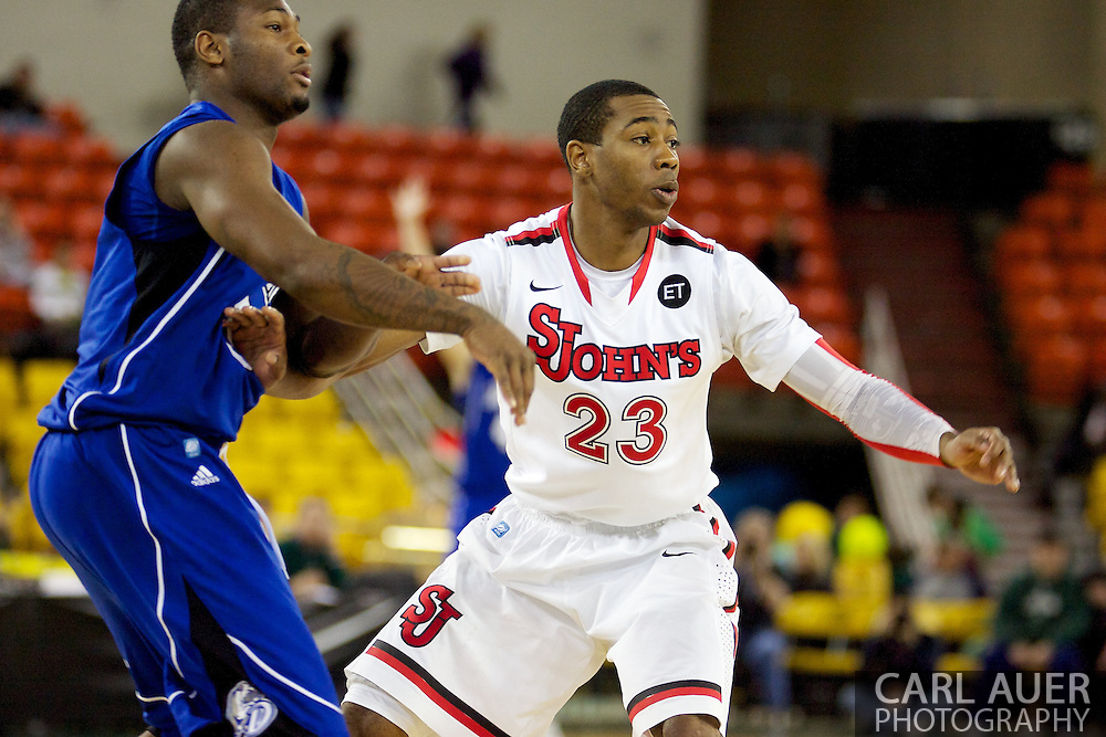 November 26th, 2010:  Anchorage, Alaska - St. John's senior guard Paris Horne (23) in the Red Storm's semi final game of the Great Alaska Shootout against the Drake Bulldogs.  The Red Storm defense held Drake to a tournament low score as St. Johns advanced to the final game 82-39.